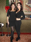 Kimberly Guilfoyle and Andrea Tantaros at a Christmas Party - December 2011